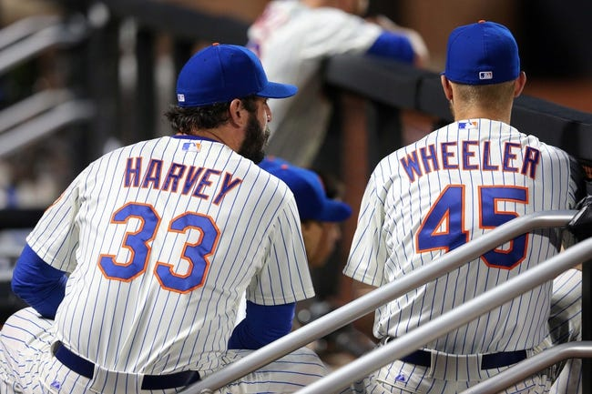 Jun 12, 2014; New York, NY, USA; New York Mets starting pitcher Matt Harvey (33) talks with Mets starting pitcher Zack Wheeler (45) in the dugout during the sixth inning against the Milwaukee Brewers at Citi Field. The Brewers won 5-1 in thirteen innings. Mandatory Credit: Brad Penner-USA TODAY Sports