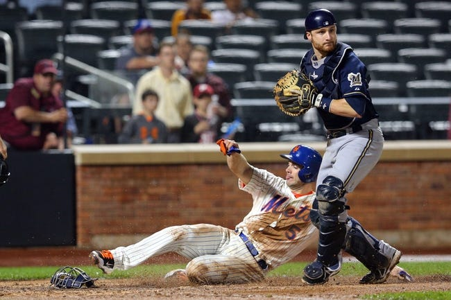 Jun 12, 2014; New York, NY, USA; New York Mets third baseman David Wright (5) is forced out at home by Milwaukee Brewers catcher Jonathan Lucroy (20) during the eleventh inning at Citi Field. The Brewers won 5-1 in thirteen innings. Mandatory Credit: Brad Penner-USA TODAY Sports