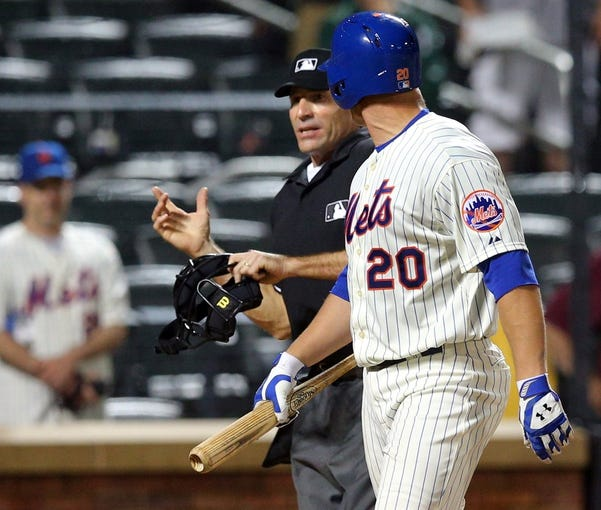 Jun 12, 2014; New York, NY, USA; New York Mets catcher Anthony Recker (20) is thrown out of the game against the Milwaukee Brewers by home plate umpire Angel Hernandez (55) for arguing balls and strikes during the eleventh inning at Citi Field. The Brewers won 5-1 in thirteen innings. Mandatory Credit: Brad Penner-USA TODAY Sports