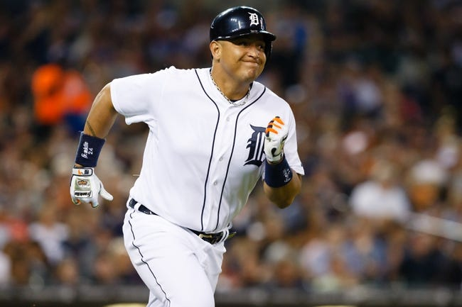 Jun 8, 2014; Detroit, MI, USA; Detroit Tigers first baseman Miguel Cabrera (24) runs towards first after he hits a double in the fourth inning against the Boston Red Sox at Comerica Park. Mandatory Credit: Rick Osentoski-USA TODAY Sports