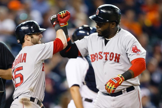 Jun 8, 2014; Detroit, MI, USA; Boston Red Sox designated hitter David Ortiz (34) receives congratulations from second baseman Dustin Pedroia (15) after he hits a three run home run in the ninth inning against the Detroit Tigers at Comerica Park. Mandatory Credit: Rick Osentoski-USA TODAY Sports
