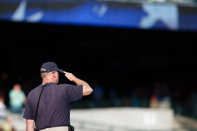 Jun 7, 2014; Detroit, MI, USA; Security member during the national anthem before the game between the Detroit Tigers and the Boston Red Sox at Comerica Park. Mandatory Credit: Rick Osentoski-USA TODAY Sports