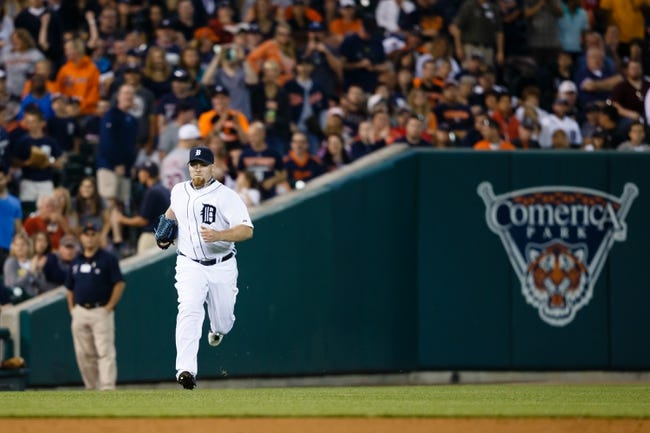 Jun 8, 2014; Detroit, MI, USA; Detroit Tigers relief pitcher Phil Coke (40) runs onto the field in the seventh inning against the Boston Red Sox at Comerica Park. Mandatory Credit: Rick Osentoski-USA TODAY Sports