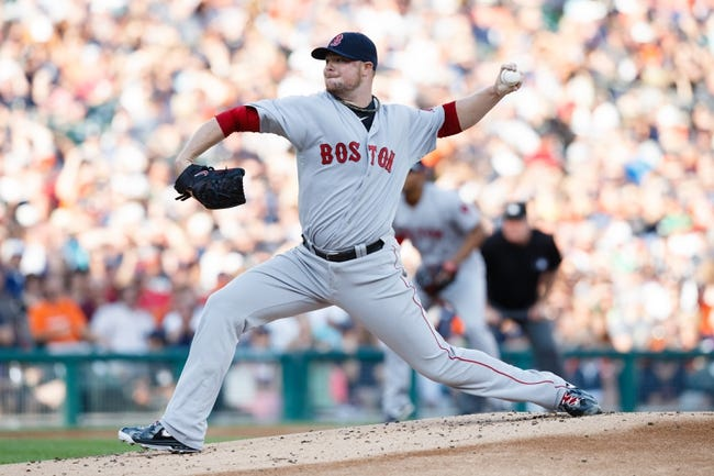 Jun 7, 2014; Detroit, MI, USA; Boston Red Sox starting pitcher Jon Lester (31) pitches in the first inning against the Detroit Tigers at Comerica Park. Mandatory Credit: Rick Osentoski-USA TODAY Sports