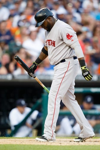 Jun 7, 2014; Detroit, MI, USA; Boston Red Sox designated hitter David Ortiz (34) walks back to the dugout against the Detroit Tigers at Comerica Park. Mandatory Credit: Rick Osentoski-USA TODAY Sports