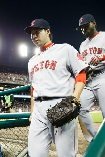 Jun 7, 2014; Detroit, MI, USA; Boston Red Sox relief pitcher Junichi Tazawa (left) and center fielder Jackie Bradley Jr. (25) walk into the dugout against the Detroit Tigers at Comerica Park. Mandatory Credit: Rick Osentoski-USA TODAY Sports