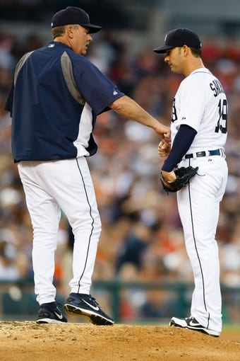 Jun 8, 2014; Detroit, MI, USA; Detroit Tigers pitching coach Jeff Jones (51) talks to starting pitcher Anibal Sanchez (19) against the Boston Red Sox at Comerica Park. Mandatory Credit: Rick Osentoski-USA TODAY Sports