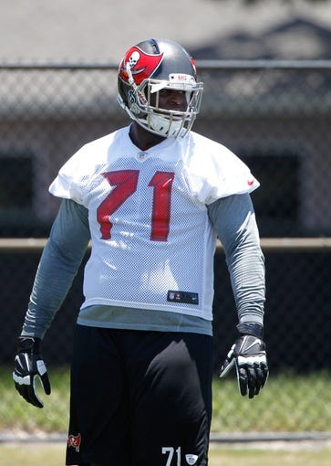 Jun 10, 2014; Tampa Bay, FL, USA;  Tampa Bay Buccaneers guard Kadeem Edwards (71) works out for mini camp at One Buccaneer Place. Mandatory Credit: Kim Klement-USA TODAY Sports
