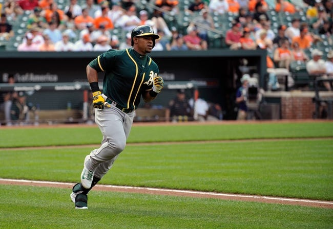 Jun 8, 2014; Baltimore, MD, USA; Oakland Athletics center fielder Yoenis Cespedes (52) heads to first after hitting a single in the sixth inning against the Baltimore Orioles at Oriole Park at Camden Yards. The Athletics defeated the Orioles 11-1. Mandatory Credit: Joy R. Absalon-USA TODAY Sports