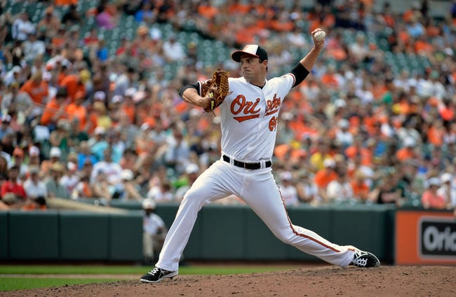Jun 8, 2014; Baltimore, MD, USA; Baltimore Orioles pitcher T.J. McFarland (66) throws in the fifth inning against the Oakland Athletics at Oriole Park at Camden Yards. The Athletics defeated the Orioles 11-1. Mandatory Credit: Joy R. Absalon-USA TODAY Sports