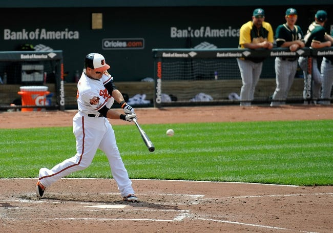 Jun 8, 2014; Baltimore, MD, USA; Baltimore Orioles designated hitter Steve Pearce (28) doubles in the fifth inning against the Oakland Athletics at Oriole Park at Camden Yards. The Athletics defeated the Orioles 11-1. Mandatory Credit: Joy R. Absalon-USA TODAY Sports