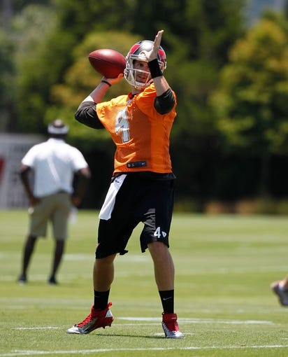 Jun 10, 2014; Tampa Bay, FL, USA;  Tampa Bay Buccaneers quarterback Alex Tanney (4) works out for mini camp at One Buccaneer Place. Mandatory Credit: Kim Klement-USA TODAY Sports