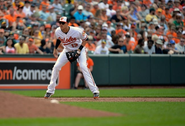 Jun 8, 2014; Baltimore, MD, USA; Baltimore Orioles third baseman Manny Machado (13) during a game against the Oakland Athletics at Oriole Park at Camden Yards. The Athletics defeated the Orioles 11-1. Mandatory Credit: Joy R. Absalon-USA TODAY Sports