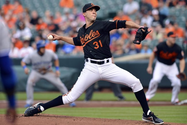 Jun 13, 2014; Baltimore, MD, USA; Baltimore Orioles starting pitcher Ubaldo Jimenez (31) pitches during the first inning against the Toronto Blue Jays  at Oriole Park at Camden Yards. Mandatory Credit: Tommy Gilligan-USA TODAY Sports