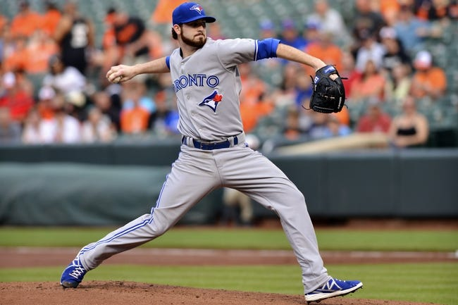 Jun 13, 2014; Baltimore, MD, USA; Toronto Blue Jays starting pitcher Drew Hutchison (36) pitches during the first inning against the Baltimore Orioles  at Oriole Park at Camden Yards. Mandatory Credit: Tommy Gilligan-USA TODAY Sports