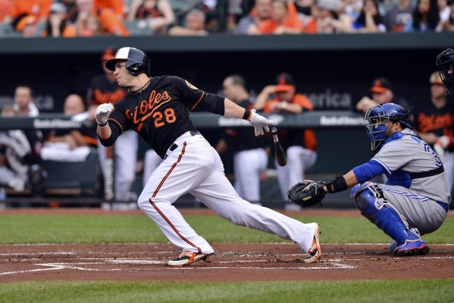 Jun 13, 2014; Baltimore, MD, USA; Baltimore Orioles first baseman Steve Pearce (28) singles during the first inning  against the Toronto Blue Jays at Oriole Park at Camden Yards. Mandatory Credit: Tommy Gilligan-USA TODAY Sports