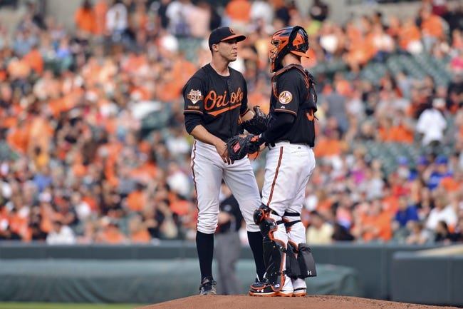 Jun 13, 2014; Baltimore, MD, USA; Baltimore Orioles catcher Caleb Joseph (36) speaks with  starting pitcher Ubaldo Jimenez (31) on the mound during the second inning Toronto Blue Jays  at Oriole Park at Camden Yards. Mandatory Credit: Tommy Gilligan-USA TODAY Sports