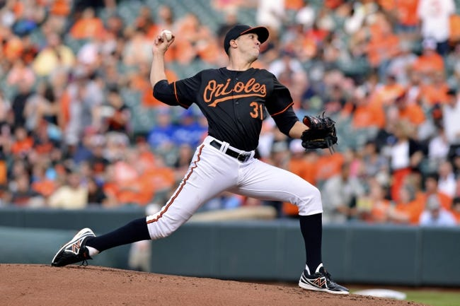 Jun 13, 2014; Baltimore, MD, USA; Baltimore Orioles starting pitcher Ubaldo Jimenez (31) pitches during the second inning  against the Toronto Blue Jays at Oriole Park at Camden Yards. Mandatory Credit: Tommy Gilligan-USA TODAY Sports