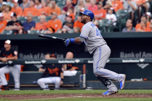 Jun 13, 2014; Baltimore, MD, USA; Toronto Blue Jays third baseman Juan Francisco (47) hits a two-run home run during the second inning against the Baltimore Orioles   at Oriole Park at Camden Yards. Mandatory Credit: Tommy Gilligan-USA TODAY Sports