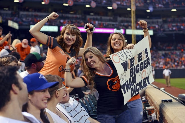 Jun 13, 2014; Baltimore, MD, USA; Baltimore Orioles fans hold a sign during the fifth inning against the Toronto Blue Jays  at Oriole Park at Camden Yards. Mandatory Credit: Tommy Gilligan-USA TODAY Sports