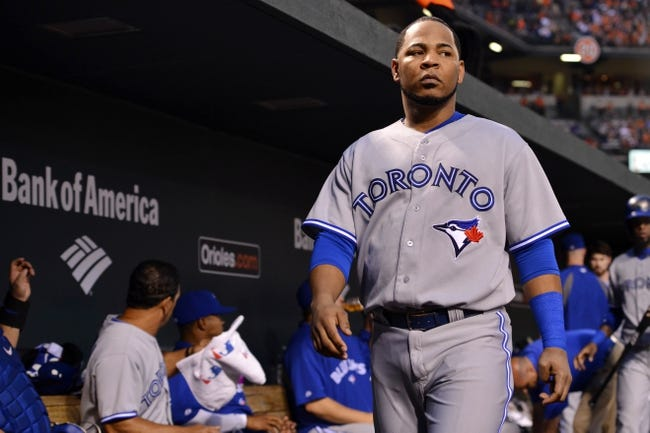 Jun 13, 2014; Baltimore, MD, USA; Toronto Blue Jays first baseman Edwin Encarnacion (10) walks through the dugout during the sixth inning against the Baltimore Orioles  at Oriole Park at Camden Yards. Mandatory Credit: Tommy Gilligan-USA TODAY Sports
