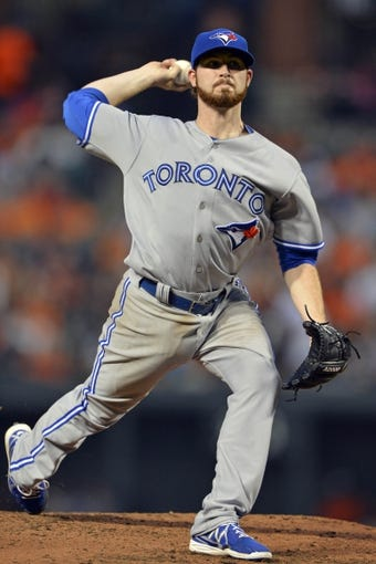 Jun 13, 2014; Baltimore, MD, USA; Toronto Blue Jays starting pitcher Drew Hutchison (36) pitches during the fifth inning against the Baltimore Orioles at Oriole Park at Camden Yards. Mandatory Credit: Tommy Gilligan-USA TODAY Sports