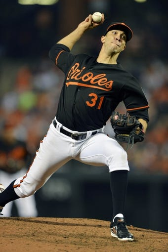 Jun 13, 2014; Baltimore, MD, USA; Baltimore Orioles starting pitcher Ubaldo Jimenez (31) pitches during the sixth inning against the Toronto Blue Jays  at Oriole Park at Camden Yards. Mandatory Credit: Tommy Gilligan-USA TODAY Sports