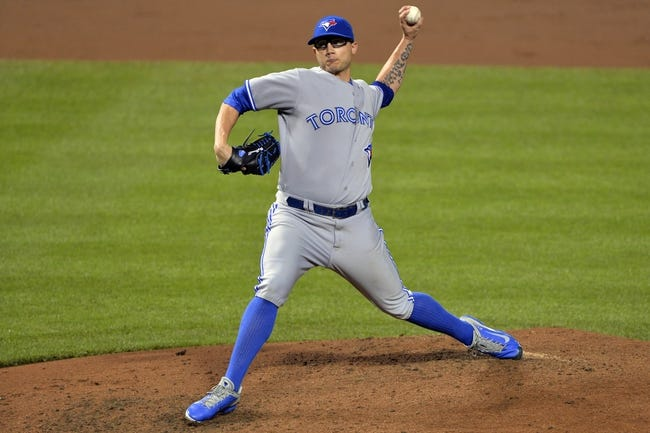 Jun 13, 2014; Baltimore, MD, USA; Toronto Blue Jays relief pitcher Brett Cecil (27) pitches during the eighth inning inning against the Baltimore Orioles at Oriole Park at Camden Yards. Toronto Blue Jays defeated Baltimore Orioles 4-0. Mandatory Credit: Tommy Gilligan-USA TODAY Sports