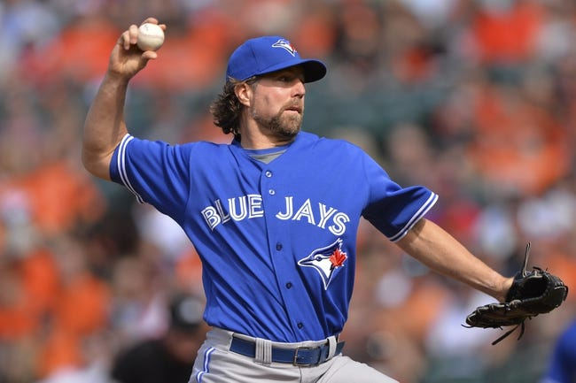 Jun 14, 2014; Baltimore, MD, USA;  Toronto Blue Jays starting pitcher R.A. Dickey (43) pitches during the first inning against the Baltimore Orioles at Oriole Park at Camden Yards. Mandatory Credit: Tommy Gilligan-USA TODAY Sports