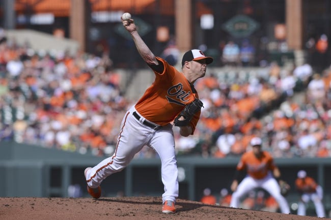 Jun 14, 2014; Baltimore, MD, USA;  Baltimore Orioles starting pitcher Bud Norris (25) pitches during the second inning against the Toronto Blue Jays at Oriole Park at Camden Yards. Mandatory Credit: Tommy Gilligan-USA TODAY Sports