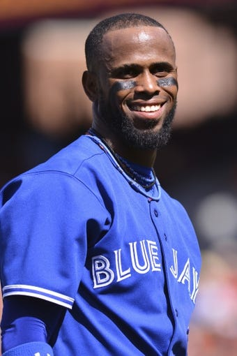 Jun 14, 2014; Baltimore, MD, USA; Toronto Blue Jays shortstop Jose Reyes (7) stands on the field after the top of the first inning against the Baltimore Orioles   at Oriole Park at Camden Yards. Mandatory Credit: Tommy Gilligan-USA TODAY Sports