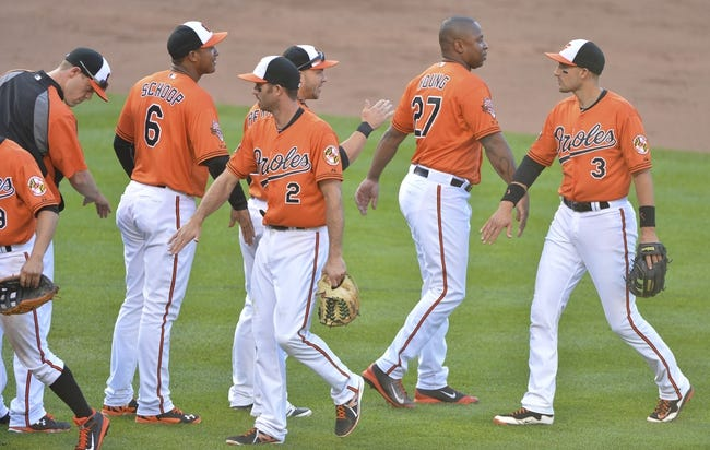 Jun 14, 2014; Baltimore, MD, USA;  Baltimore Orioles celebrates after defeating the Toronto Blue Jays 3-2 at Oriole Park at Camden Yards. Mandatory Credit: Tommy Gilligan-USA TODAY Sports