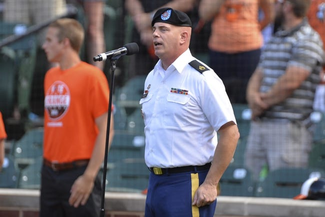 Jun 14, 2014; Baltimore, MD, USA;  U.S. Army Staff sergeant Randy White sings the national anthem prior to the game between the Toronto Blue Jays and Baltimore Orioles at Oriole Park at Camden Yards. Baltimore Orioles defeats the Toronto Blue Jays 3-2. Mandatory Credit: Tommy Gilligan-USA TODAY Sports