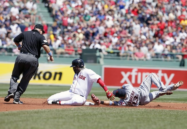 Jun 15, 2014; Boston, MA, USA; Boston Red Sox designated hitter David Ortiz (34) drives in a run but is tagged out at second base by Cleveland Indians shortstop Asdrubal Cabrera (13) in the first inning at Fenway Park. Mandatory Credit: David Butler II-USA TODAY Sports
