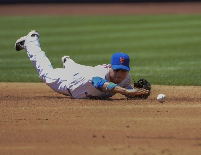 Jun 15, 2014; New York, NY, USA; New York Mets shortstop Wilmer Flores (4) cannot field a ground ball 