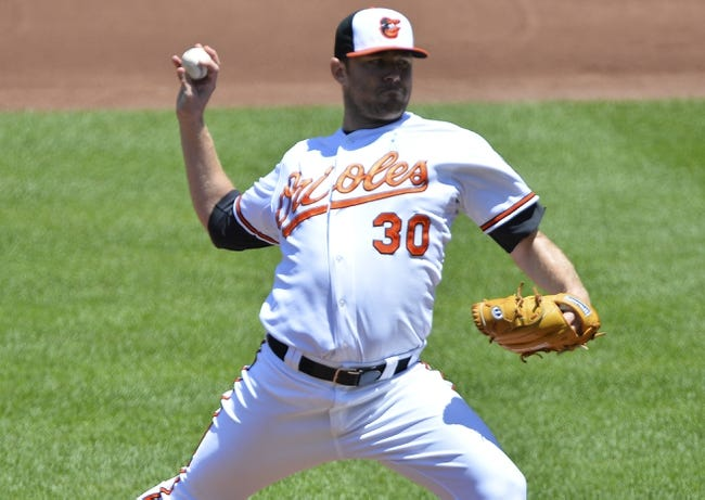 Jun 15, 2014; Baltimore, MD, USA;  Baltimore Orioles starting pitcher Chris Tillman (30) pitches during the first inning against the Toronto Blue Jays at Oriole Park at Camden Yards. Mandatory Credit: Tommy Gilligan-USA TODAY Sports