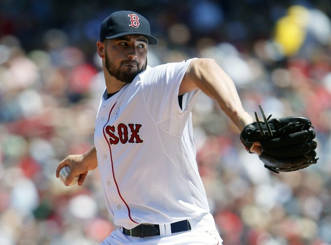 Jun 15, 2014; Boston, MA, USA; Boston Red Sox starting pitcher Brandon Workman (67) throws a pitch against the Cleveland Indians in the first inning at Fenway Park. Mandatory Credit: David Butler II-USA TODAY Sports