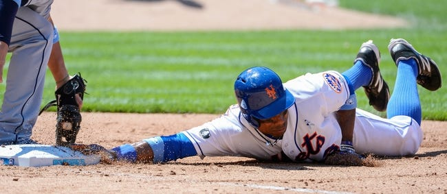 Jun 15, 2014; New York, NY, USA; New York Mets right fielder Curtis Granderson (3) dives back to first base during the game against the San Diego Padres at Citi Field. Mandatory Credit: Robert Deutsch-USA TODAY Sports