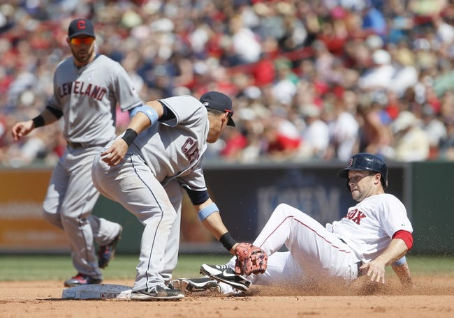 Jun 15, 2014; Boston, MA, USA; Boston Red Sox right fielder Daniel Nava (29) is tagged out trying to steal second base by Cleveland Indians shortstop Asdrubal Cabrera (13) in the fourth inning at Fenway Park. Mandatory Credit: David Butler II-USA TODAY Sports