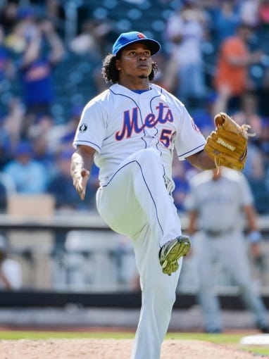 Jun 15, 2014; New York, NY, USA; New York Mets relief pitcher Jenrry Mejia (58) watches the last out during the ninth inning against the San Diego Padres at Citi Field. Mandatory Credit: Robert Deutsch-USA TODAY Sports