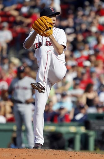 Jun 15, 2014; Boston, MA, USA; Boston Red Sox relief pitcher Koji Uehara (19) throws a pitch against the Cleveland Indians in the ninth inning at Fenway Park. Mandatory Credit: David Butler II-USA TODAY Sports