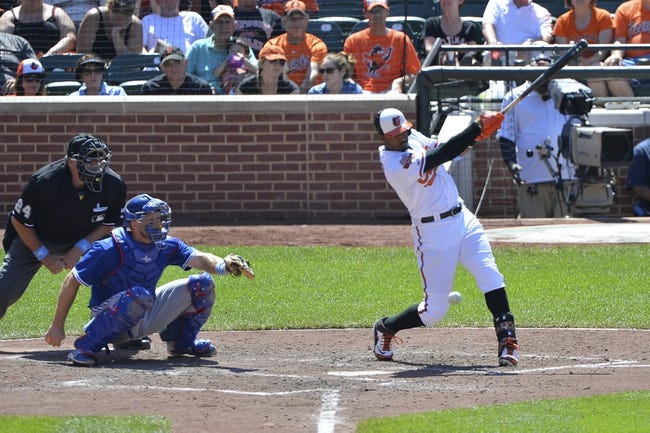 Jun 15, 2014; Baltimore, MD, USA;  Baltimore Orioles center fielder Adam Jones (10) doubles in the sixth inning against the Toronto Blue Jays at Oriole Park at Camden Yards. Toronto Blue Jays defeats the Baltimore Orioles 5-2. Mandatory Credit: Tommy Gilligan-USA TODAY Sports
