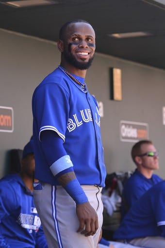 Jun 15, 2014; Baltimore, MD, USA;  Toronto Blue Jays shortstop Jose Reyes (7) stands in the dugout during the eighth inning against the Baltimore Orioles at Oriole Park at Camden Yards. Toronto Blue Jays defeat the Baltimore Orioles 5-2. Mandatory Credit: Tommy Gilligan-USA TODAY Sports