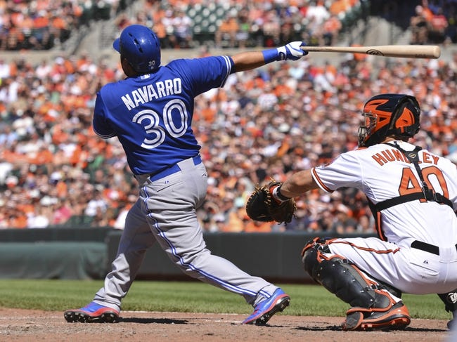 Jun 15, 2014; Baltimore, MD, USA;  Toronto Blue Jays catcher Dioner Navarro (30) hits a rbi single during the eighth inning against the Baltimore Orioles at Oriole Park at Camden Yards. Toronto Blue Jays defeat the Baltimore Orioles 5-2. Mandatory Credit: Tommy Gilligan-USA TODAY Sports