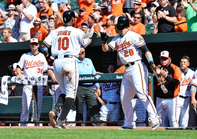 Jun 15, 2014; Baltimore, MD, USA;  Baltimore Orioles center fielder Adam Jones (10) celebrates with  first baseman Steve Pearce (28) after hitting a solo home run in the eighth inning against the Toronto Blue Jays at Oriole Park at Camden Yards. Toronto Blue Jays defeat the Baltimore Orioles 5-2. Mandatory Credit: Tommy Gilligan-USA TODAY Sports