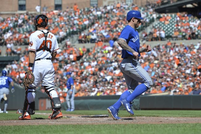 Jun 15, 2014; Baltimore, MD, USA; Toronto Blue Jays third baseman Brett Lawrie (13) scores in the eighth inning against the Baltimore Orioles  at Oriole Park at Camden Yards. Toronto Blue Jays defeats the Baltimore Orioles 5-2. Mandatory Credit: Tommy Gilligan-USA TODAY Sports