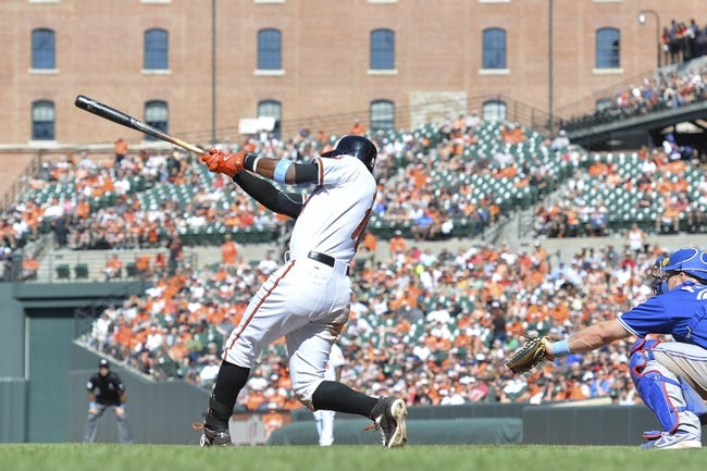 Jun 15, 2014; Baltimore, MD, USA;  Baltimore Orioles center fielder Adam Jones (10) hits a solo home run in the eighth inning against the Toronto Blue Jays at Oriole Park at Camden Yards. Toronto Blue Jays defeats the Baltimore Orioles 5-2. Mandatory Credit: Tommy Gilligan-USA TODAY Sports