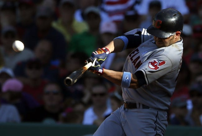 Jun 15, 2014; Boston, MA, USA; Cleveland Indians first baseman Nick Swisher (33) hits a go ahead home run against the Boston Red Sox in the eleventh inning at Fenway Park. Mandatory Credit: David Butler II-USA TODAY Sports