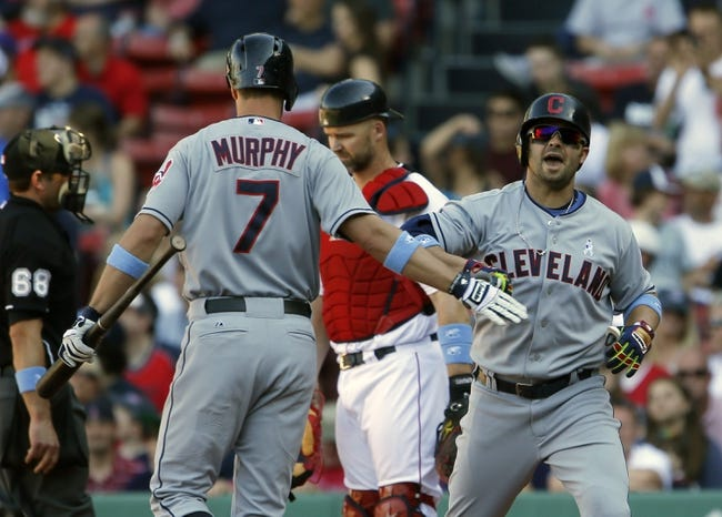 Jun 15, 2014; Boston, MA, USA; Cleveland Indians first baseman Nick Swisher (33) reacts with teammate right fielder David Murphy (7) after hitting a go ahead home run against the Boston Red Sox in the eleventh inning at Fenway Park. Mandatory Credit: David Butler II-USA TODAY Sports