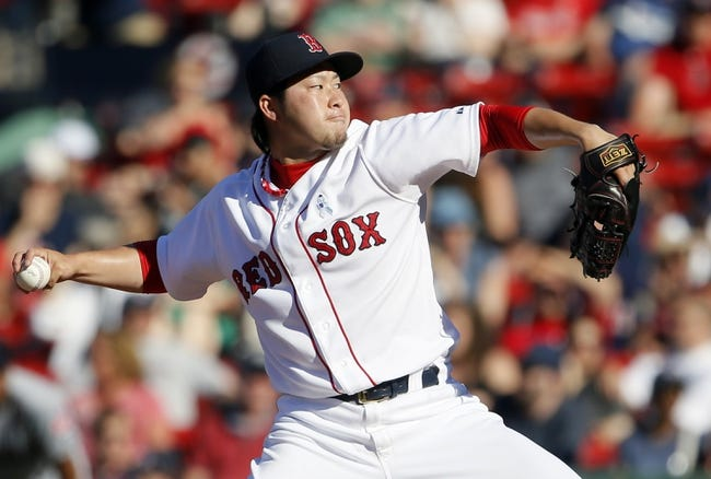 Jun 15, 2014; Boston, MA, USA; Boston Red Sox relief pitcher Junichi Tazawa (36) throws a pitch against the Cleveland Indians in the eleventh inning at Fenway Park. Mandatory Credit: David Butler II-USA TODAY Sports